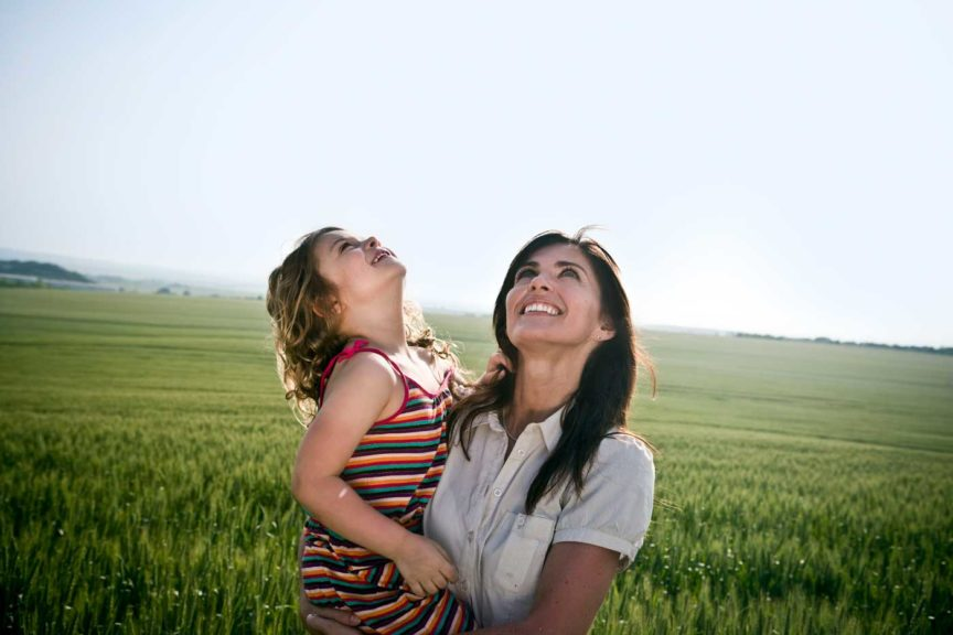 woman-and-child-looking-at-sky-open-space
