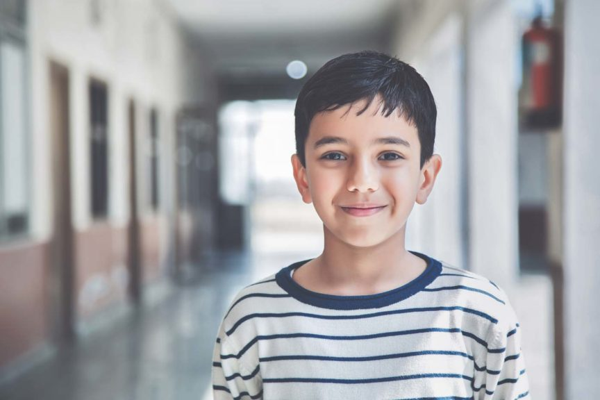 Portrait of a young school boy smiling